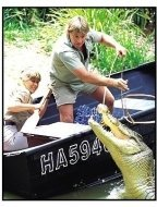 The Crocodile Hunter: Collision Course movie still: Steve Irwin and Terri Irwin try to get a jaw rope around a ferocious 12-foot croc