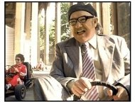 The Royal Tenenbaums movie still: Royal Tenenbaum (Gene Hackman) takes his grandchildren out for a day outside of the watchful eye of their father