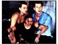 Resident Evil movie still: Alice (Milla Jovovich) and her team Rain (Michelle Rodriguez) and Matt (Eric Mabius)