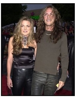 Slaughter member Blas Elias and date at the Rock Star premiere