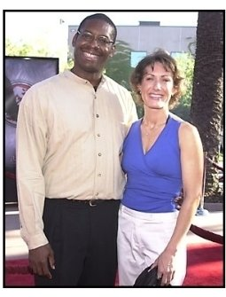 Bruce A Young and date at the Jurassic Park III Premiere