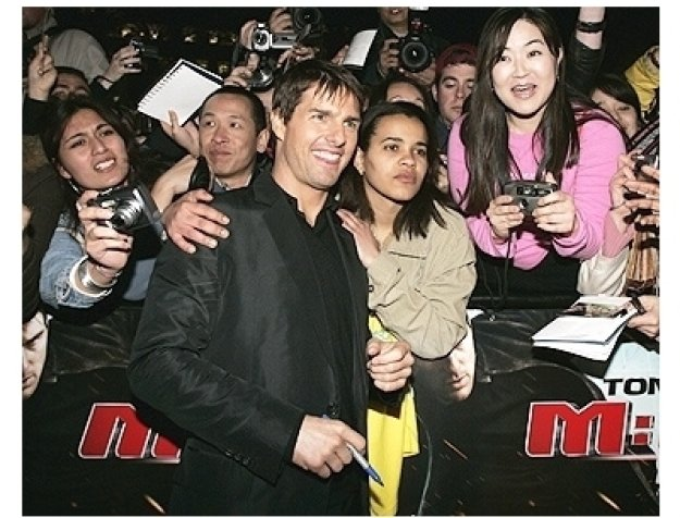 Tom Cruise poses with fans at the London Premiere of  Mission: Impossible III